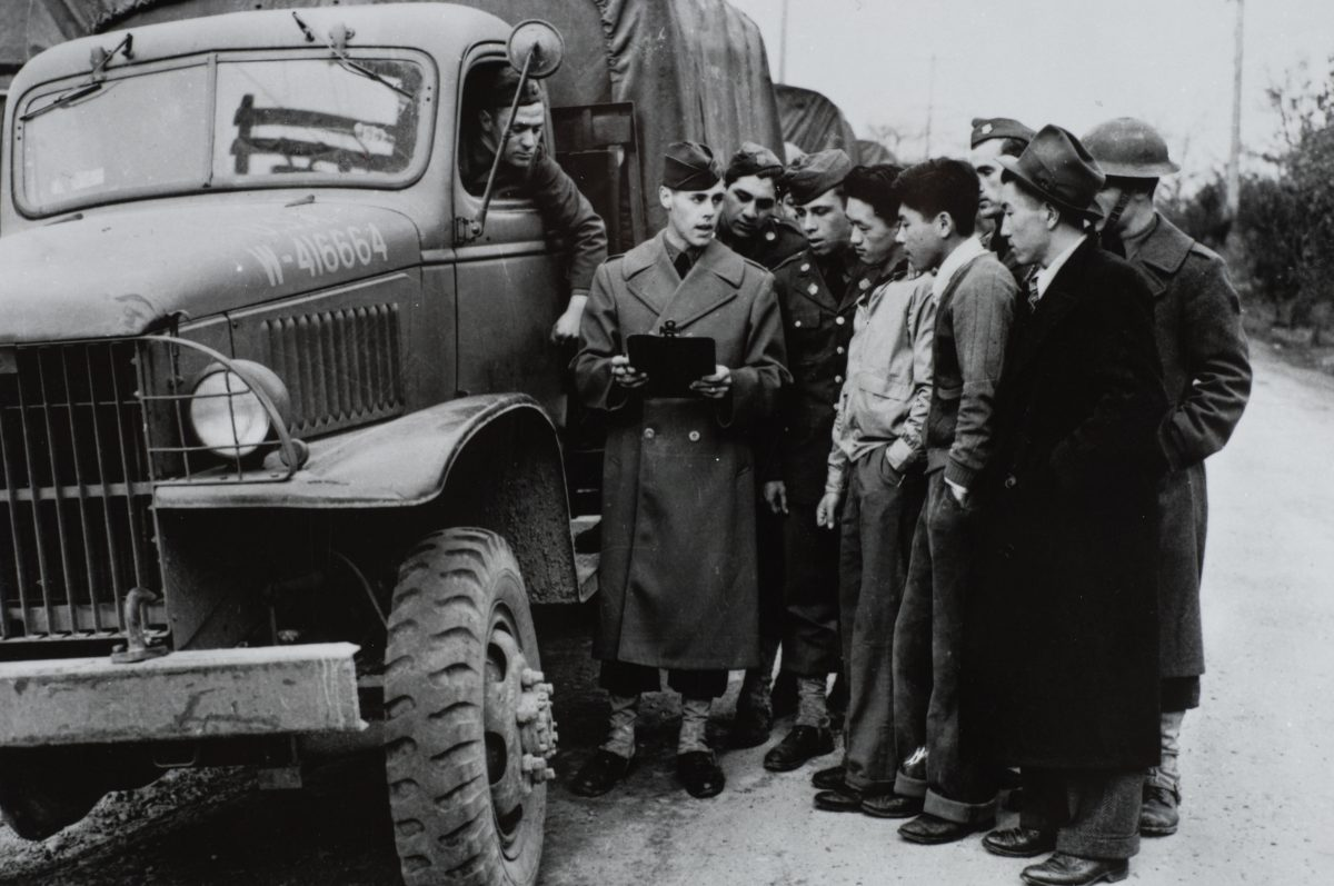 Soldiers and Three Nisei Men on Evacuation Day